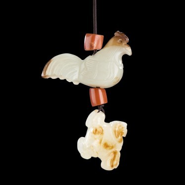 A GROUP OF TWO CHINESE WHITE AND RUSSET JADE PENDANTS (ROOSTER FROM SONG...